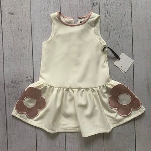 White dress with pink floral pockets for toddler